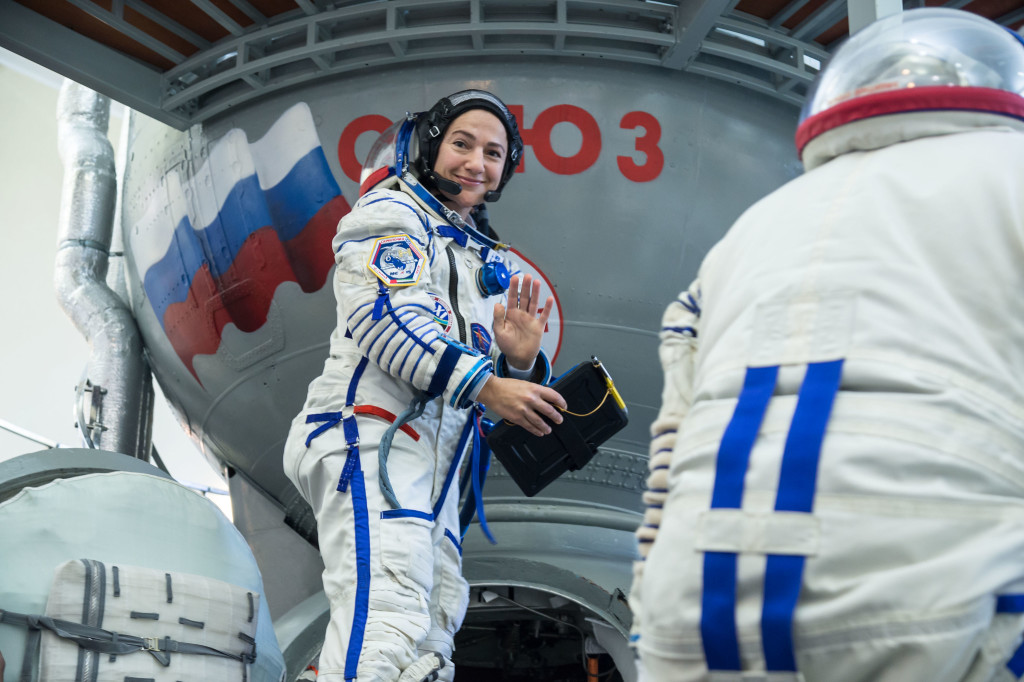 jsc2019e051848 - At the Gagarin Cosmonaut Training Center in Star City, Russia, Expedition 61 crewmember Jessica Meir of NASA climbs aboard a Soyuz trainer during final crew qualification exams Aug. 30. Meir will launch with Expedition 61 crewmember Oleg